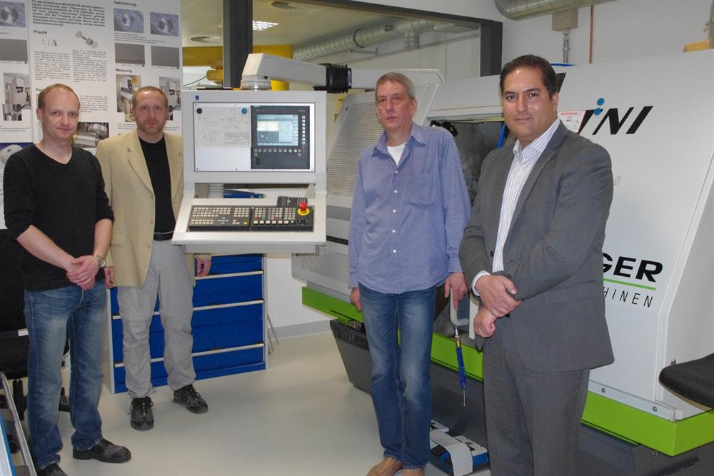 Stephan Metschke, Dr Daniel Hagedorn and Heinz-Peter Heyne in the scientific machine design department at PTB, with Shahram Essam
